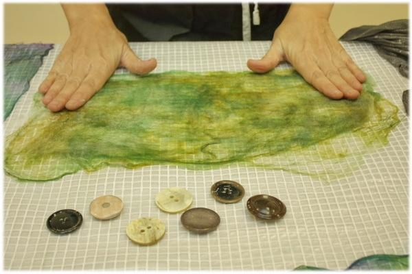 Between two silk handkerchiefs decompose thin layer of wool. Damp, grind, dried iron - get a silk prefelt air. Tie buttons in, felt onto the piece, cut buttons out and cut to make petals, add bead