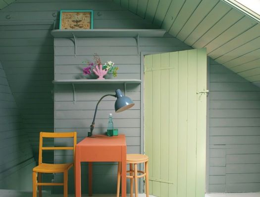 Farrow & Ball, a paint and wallpaper company, suggests these colors: Wall - Manor House Gray (No. 265); door and ceiling - Cooking Apple Green (No. 32); desk - Red Earth (No. 64); chair - India Yellow (No. 66); stool - Fowler Pink (No. 39); frame - Arsenic (No. 214); vase - Cinder Rose (No. 246).