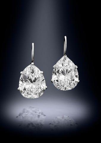 A pair of diamond earrings …