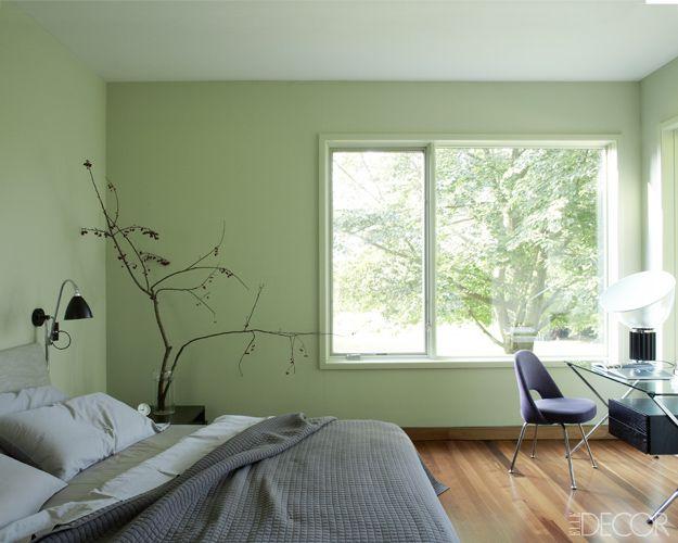bedroom light green walls beige upholstered headboard light grey