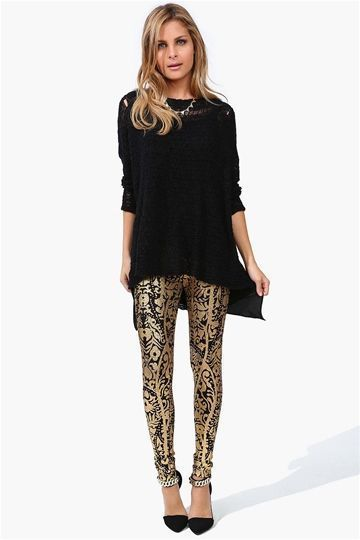 This is sooo me! Love those gold leggings and long sweater