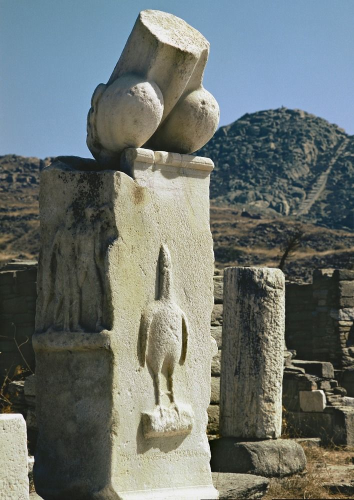 "This forlorn but impressive stump is one of two monumental phalluses in Dionysus' sanctuary on Delos. Though their full extent can't be ascertained, it's unlikely they measured up to the one that Ptolemy Philadelphus displayed in his Great Parade @ Alexandria: ""a gold phallus one hundred and eighty feet long, painted in various colors and bound with golden garlands. Its tip had a gold star 9 ft in circumference (Athenaeus Wise Men @ Dinner)."