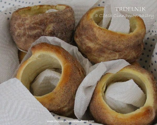 This Czech Cinnamon Pastry-Trdelnik is sold by street vendors all over Prague, A yeast dough, wrapped around a cylinder, rolled in cinnamon sugar and then baked over an open flame.