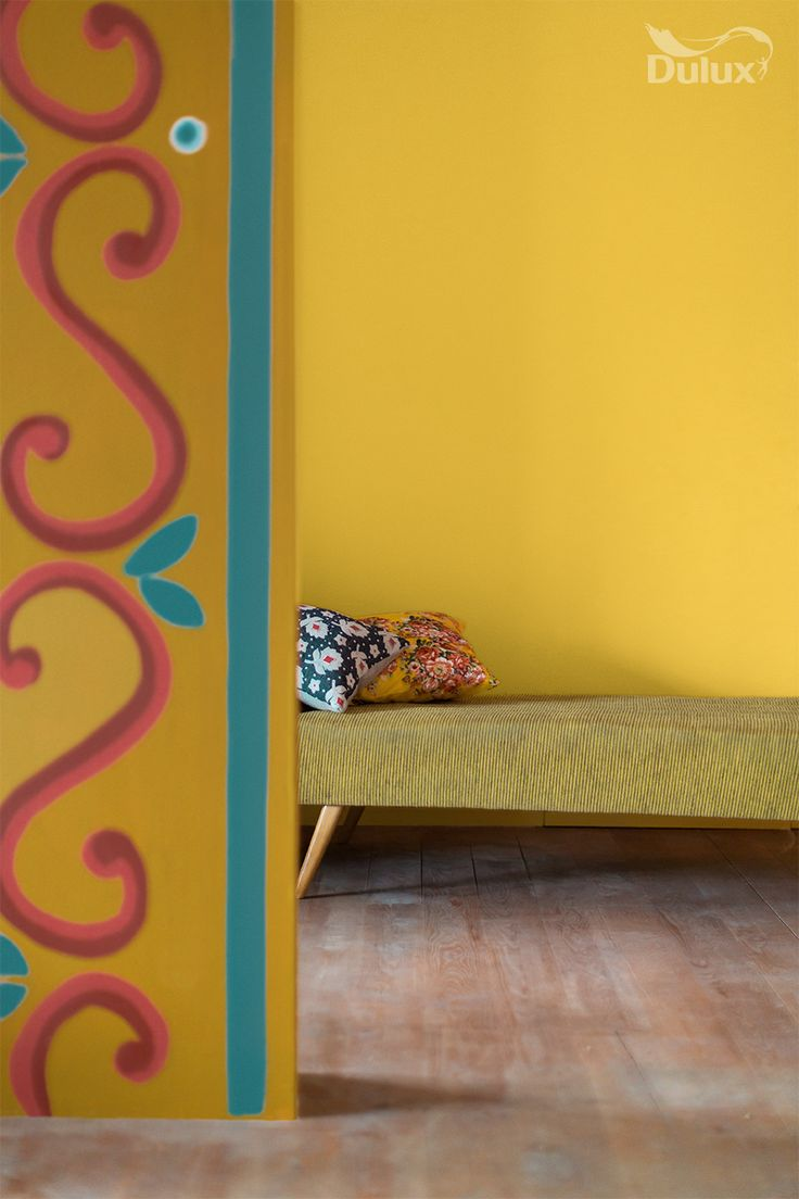 This hand-painted motif takes inspiration from folkloric patterns and brings joy to this sunny room.