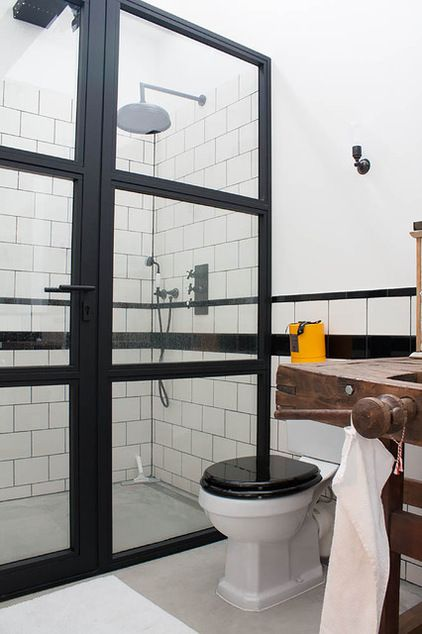 glass shower, especially like the door industrial bathroom by Louise de Miranda