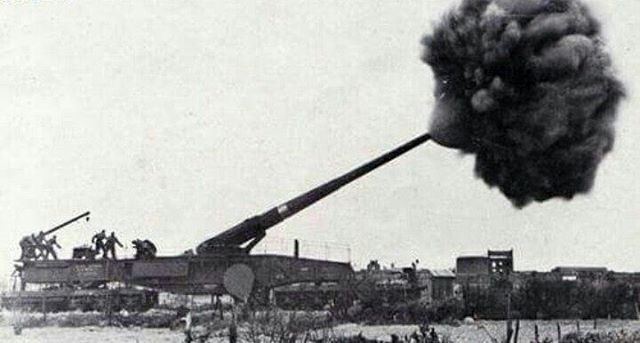 "The Krupp K5 ""Leopold"" railway gun at the moment of firing a  shell from it's 283cm caliber barrel"
