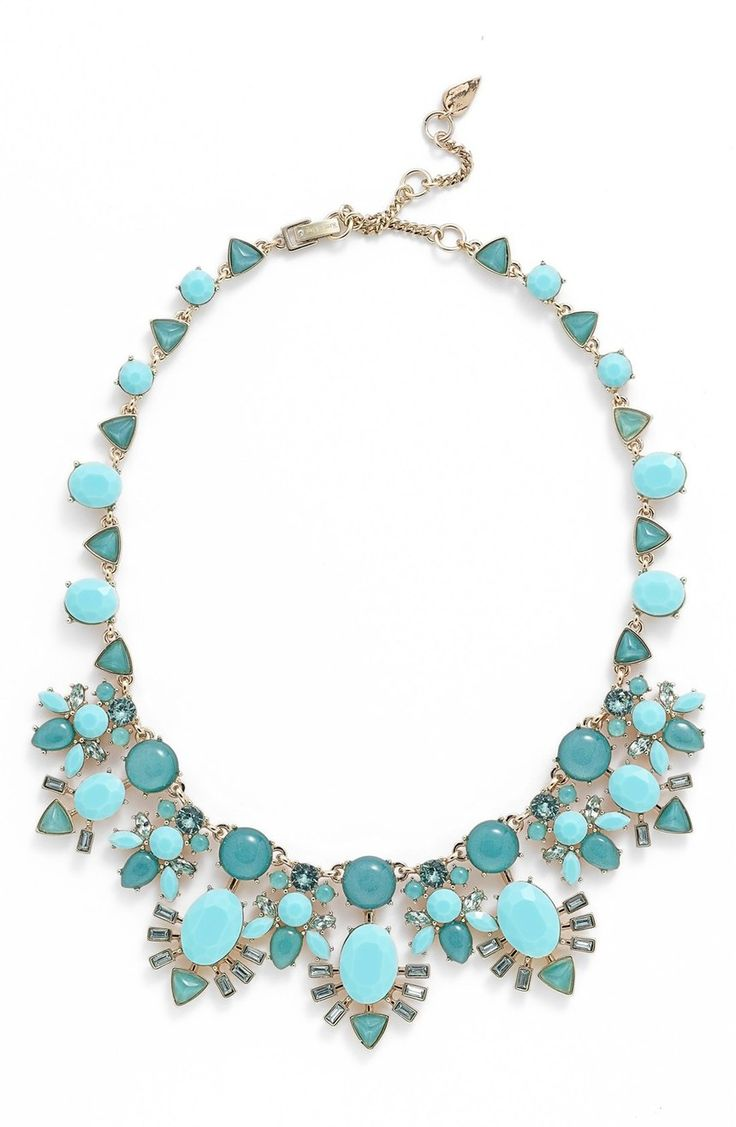 A mix of faceted jewels and glossy baubles pepper this statement-making frontal necklace that adds light-catching shine to any neckline.