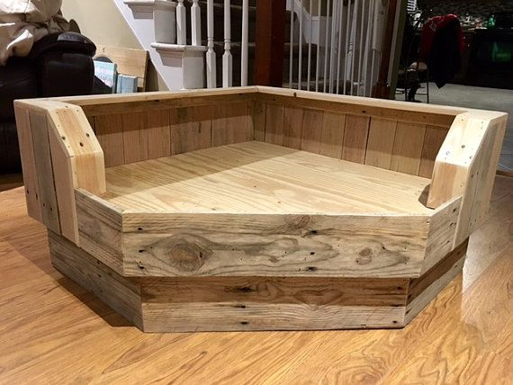 Handcrafted large pallet dog bed designed to fit conveniently in the corner of your room! The back sides of the large bed (from the corner) are 35 each with the boards angled to the front at 18 each. However, if youd like different dimensions we can certainly make the bed to fit your specs so please send us a message. Please select a stain color and provide your dogs name in the notes to seller at checkout (if youd like it personalized). ***If youre local to the Raleigh area, please feel…