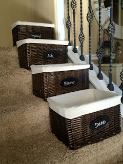 Baskets for each person to put away their stuff. Clever assuming your stairs have enough room.