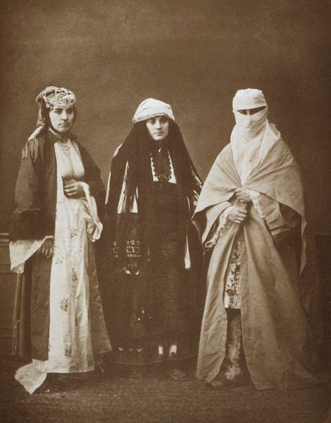 Traditional costumes of (from right to left) a married Muslim woman of Selanik (Salonika); a married Jewish woman of Selanik (Salonika); and a Bulgarian woman of Perlèpè (Prilep). From the album Les costumes populaires de la Turquie en 1873 (Popular costumes of Turkey in 1873). This album depicting ethnic costumes from throughout the Ottoman Empire was commissioned by the Ottoman government for the 1873 International Fair in Vienna and was authored by Hamdi Bey and Victor Marie de Launay.
