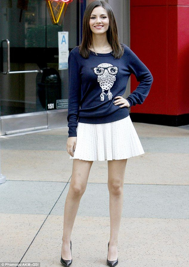 She's a hoot!The 21-year-old star was seen wearing an owl print sweater and chic white sk...