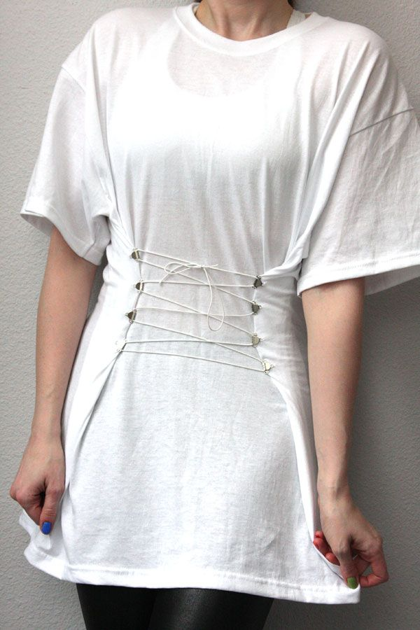 Another great DIY idea: corseted white t-shirt.  *white tunic-length t-shirt (mine is XXL)  *8 hooks from sew-on hook-and-eye sets  *white thread & hand-sewing needle  *white elastic cord  *marking chalk (not shown)  *measuring tape or ruler  Full tutorial: www.chic-steals.com