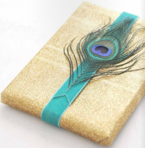 Gold glitter paper, velvet ribbon and peacock feather embellishment. A unique way to wrap gifts!