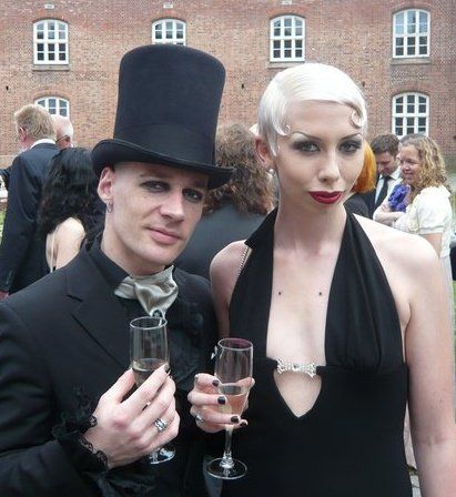 Tony Lavogez and Janne Ebbesdatter lavogez. Short white curly hair gothic couple