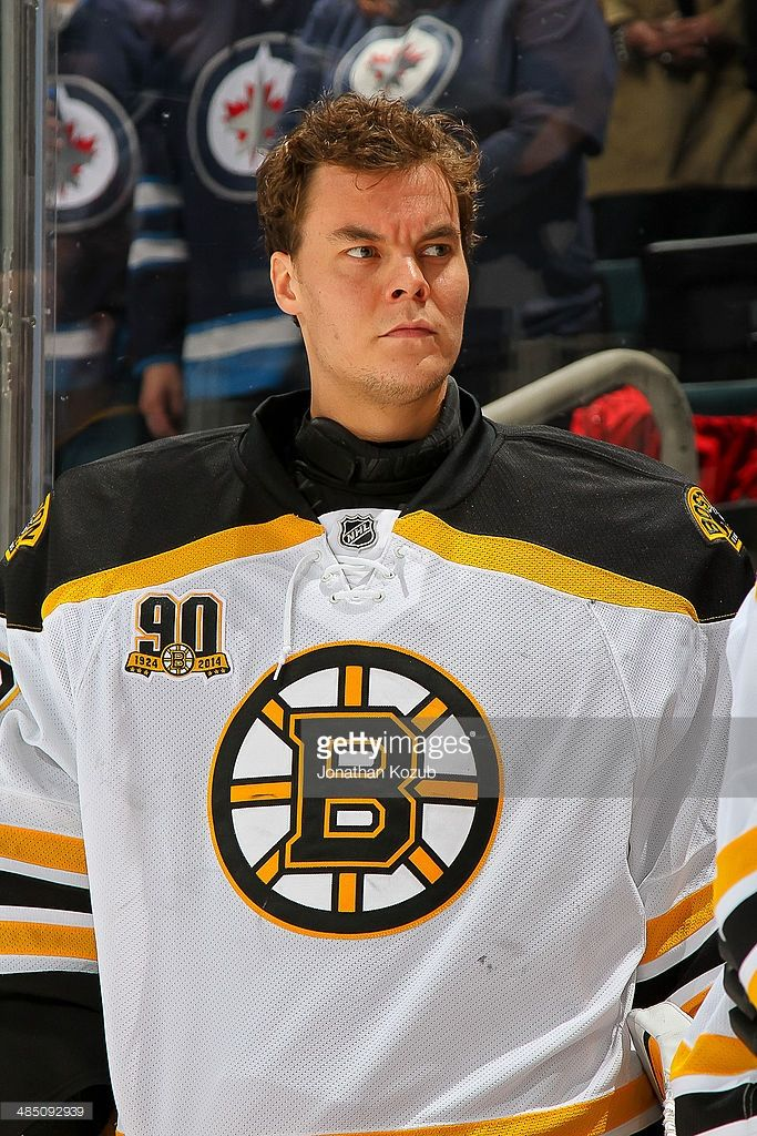 Goaltender Tuukka Rask #40 of the Boston Bruins looks on from the bench prior to puck drop against the Winnipeg Jets at the MTS Centre on April 10, 2014 in Winnipeg, Manitoba, Canada.