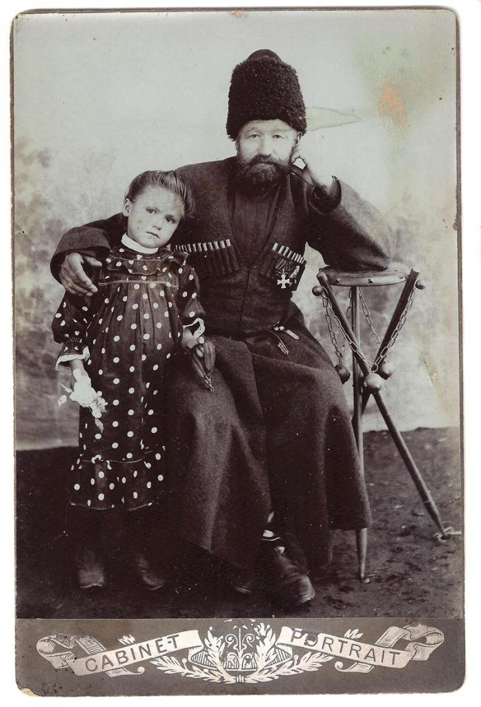 A cossack and his daughter/granddaughter, Russia, late 19th – early 20th century