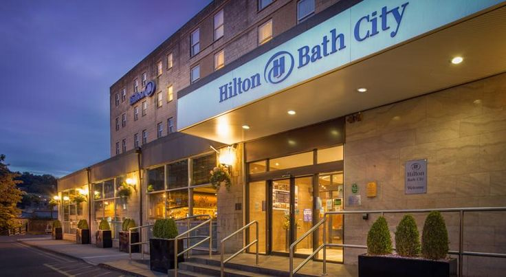 Hilton Bath City Bath Hilton Bath City is a property featuring a 60's design, situated in Bath's city centre. Guests can enjoy views of the city, River Avon and the countryside beyond.