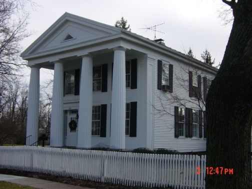 Front Text: Theodore Dreiser wrote in 1900 his famous novel, Sister Carrie, in this house. It was built in 1835 and altered to Greek Revival Style in 1844. Dreiser acquired it in 1899. The house possesses most of the features typical of the American  classic temple  including four Doric columns rising the full length of the structure. In 1967 the house is owned by the William M. Hankins family. Back Text: Same