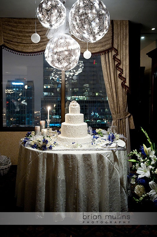 This couple made the Capital City Club look like a winter wonderland for their January wedding. Cake by Edible Art.