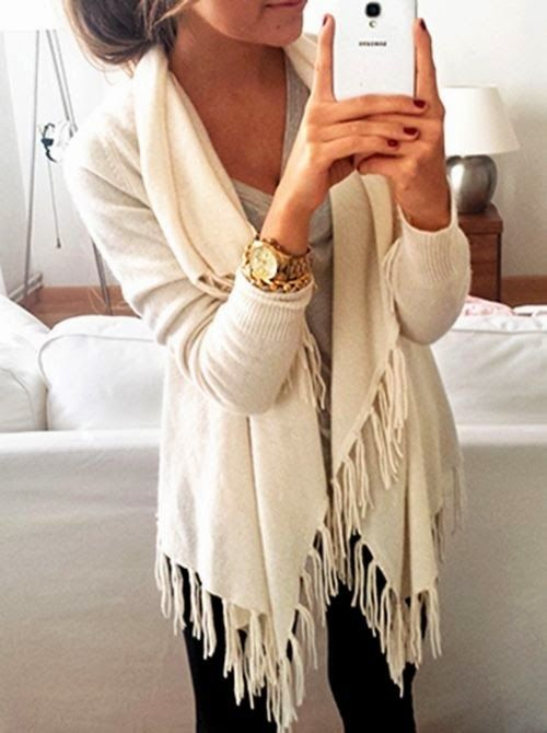 I really like the fringe on the sweater. I also like the cut. Would go great with black jeggings and some camel boots