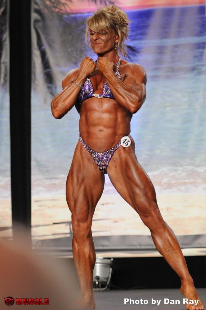Muscular Womens Dressed: Emery Miller.