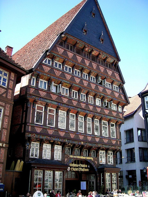 Hildesheim - The Butcher's Guild Hall, an example of half-timbered building, is one of the largest structures in the Historic Market Place of Hildesheim. With its 7 floors and a height of 26 metres, it is considered to be one of the tallest half-timbered houses in Germany. The roof has a dimension of 800 square metres. The portal has a width of 2.35 meters. The façade is decorated with colourful wood carvings, paintings and German proverbs. Repinned by www.gorara.com