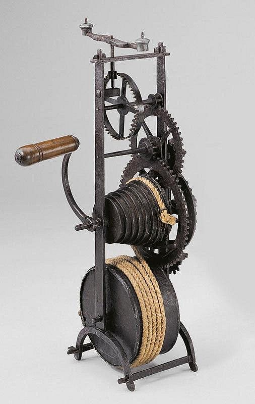 Spit Jack. Wrought Iron with Wood Handle and Clockwork Mechanism. French. Circa 18th Century. 64cm x 32cm. Used for Rotating a Spit over a Fire or near a Fireplace.