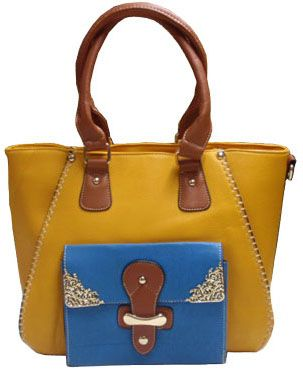 Mustard coloured bag with a front pocket decorated with silver ornaments._fashion woman accessories.