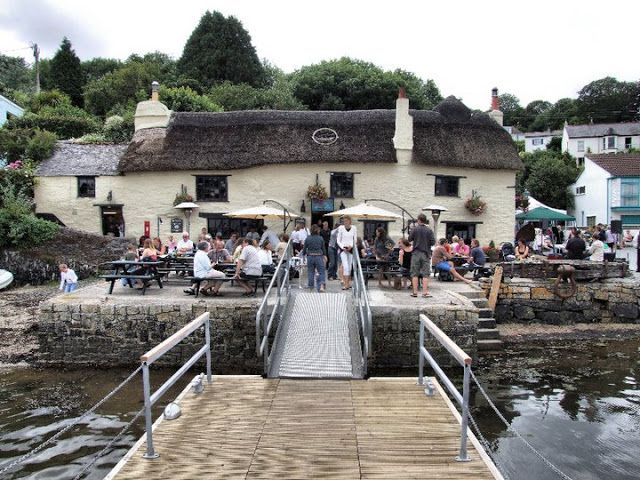 The Pandora Inn, Mylor (13th Century) is one of the oldest #Pubs in #Cornwall, #England. pandorainn.com The Pandora Inn is a classic Cornish pub with decking leading right onto the Restronguet creek. In March 2011 a fire threatened to level this beautiful 13th century pub when a fire started in the chimney. You can see the video and full story on the BBC website. #restaurant