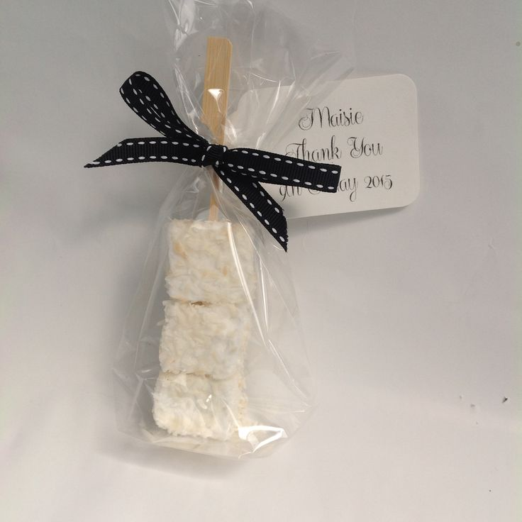 """These favours add a glamorous, original and sumptuous touch to weddings, parties and corporate events.   The drowsy, sweet creaminess of roasted coconut combined with the sharp saltiness of lime zest makes for an exotic delicacy. Freshly hand-made in small batches at Port Eliot in Cornwall with all natural ingredients. Sophie Dahl, Daisy Lowe and Kirstie Allsopp are fans.   Each bag contains three 1"""" cubed Cloud Nine marshmallows, bow-tied with our trademark grosgrain saddle stitch ribbon…"""