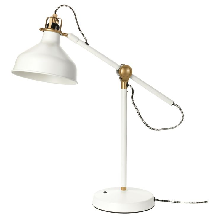Architectural and sophisticated table lamp. Love the white and gold.