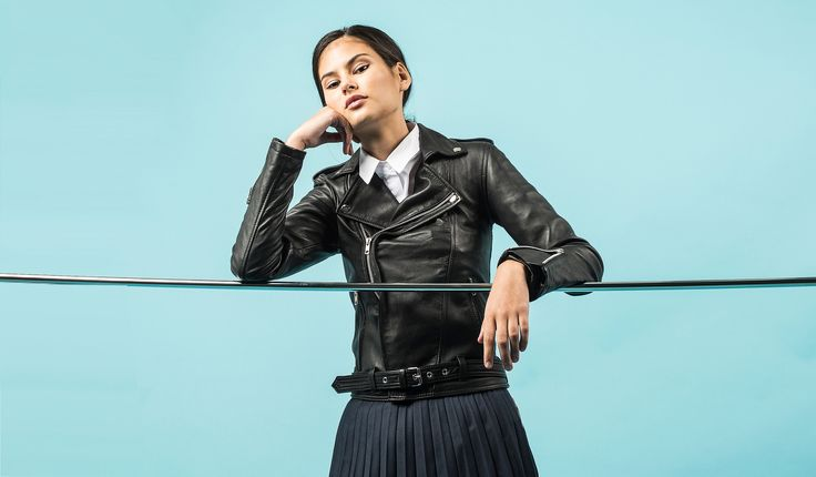Black Leather Jacket  Womens by VIPARO. Photography on silver bar. Mood Shot.
