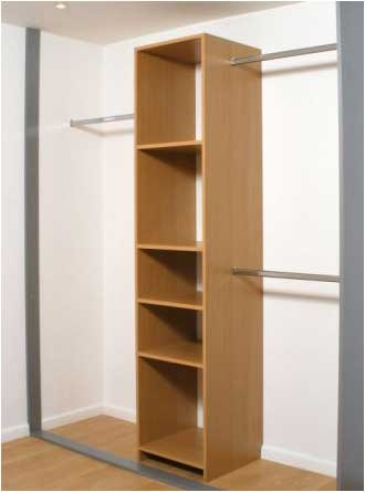 The hanging rails combined with the tall bedside cupboard/wardrobe idea could work nicely