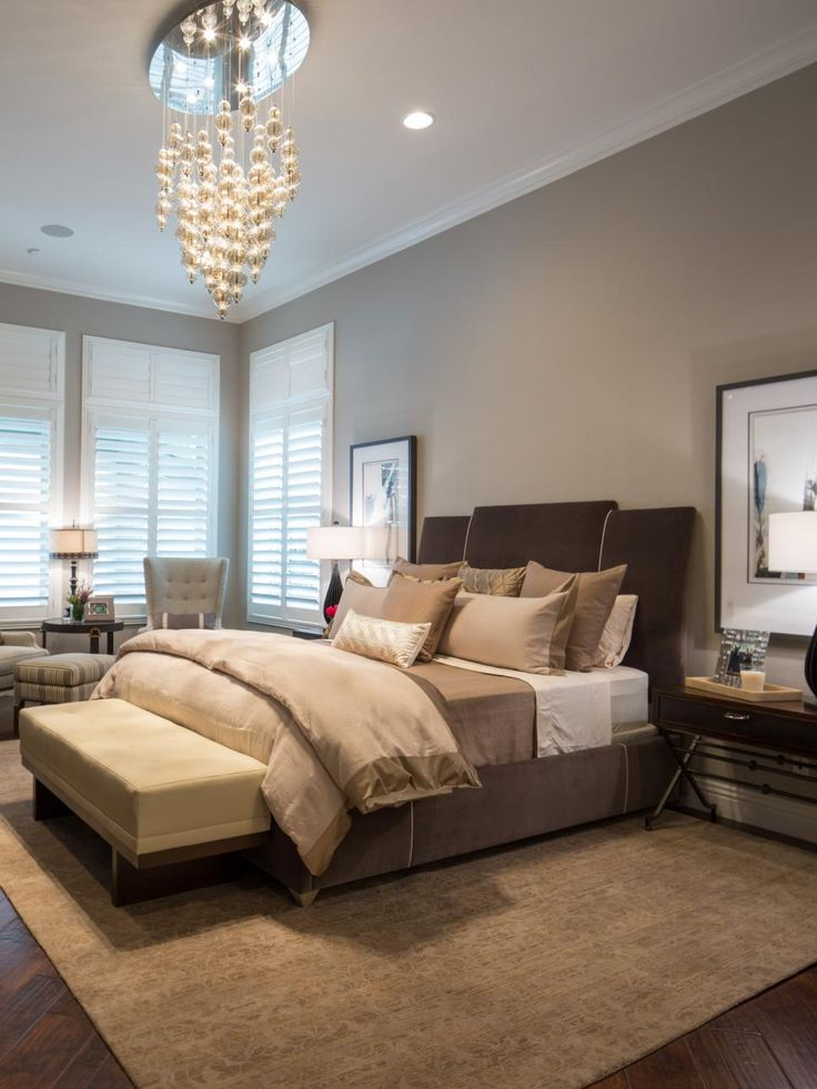 Jonathan Scott's bedroom features a mix of browns, taupes and grays for a soothing, neutral palette. A gorgeous chandelier adds a touch of whimsy to the space.