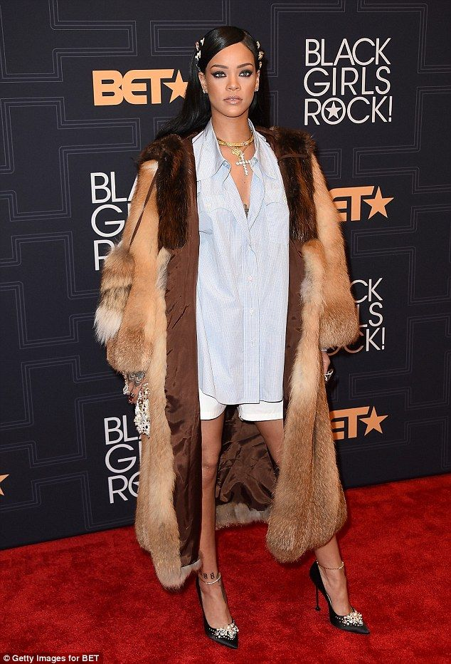 Fur goodness sake! Rihanna mixed high fashion with casual day wear with her slouchy plaid shirt, white shorts, and a nearly floor-length fur coat at Black Girls Rock! in New York City on Friday