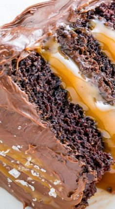 Salted Caramel Chocolate Cake Recipe ~ Three Layers of Salted Caramel Chocolate Cake Slathered in Homemade Salted Caramel Chocolate Frosting. So Decadent.