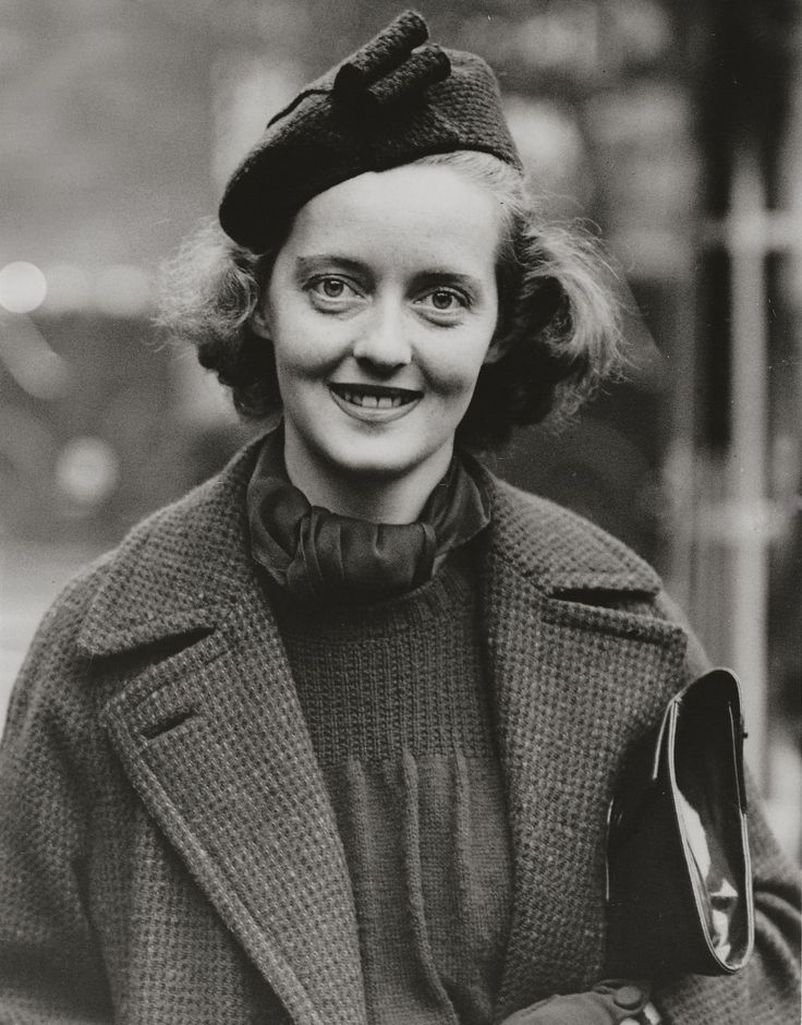 Bette Davis- this is the picture that appeared in newspapers, photo taken upon her arriving in England; Bette recently suspended and being sued by Warner Bros. for breach of contract; Bette lost the battle but won the war by being awarded superior scripts; her career subsequently flourished.