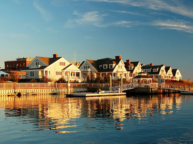 Mystic, Connecticut. The village is located on the Mystic River, which flows into Long Island Sound, providing access to the sea. The Mystic River Bascule Bridge crosses the river in the center of the village. (V)