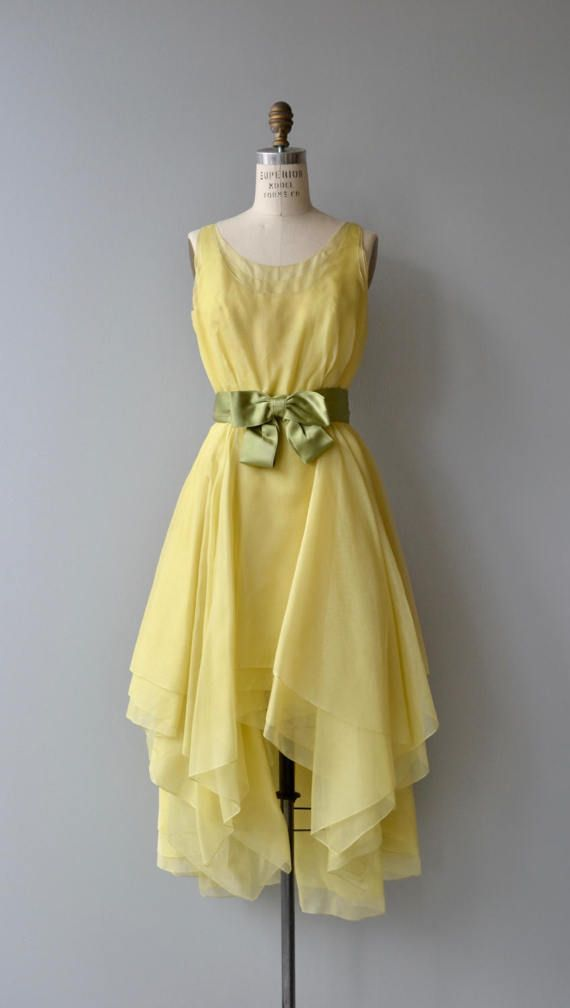 Vintage 1960s Travilla (Marilyn Monroes favorite designer) dress in bright yellow silk chiffon with stationary green satin bow, fitted waist, layered and handkerchief hem and back zip closure.  --- M E A S U R E M E N T S ---  fits like: small bust: 36 waist: 26 hip: free length: 40 (front) 52 (back) brand/maker: Travilla condition: excellent  to ensure a good fit, please read the sizing guide: http://www.etsy.com/shop/DearGolden/policy  ✩ layaway is available fo...