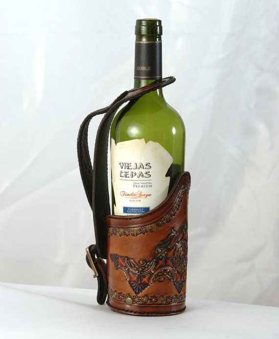 "http://etsy.me/1jGcr1w $85.00 Perfect for the wine connoisseur, the occasional dinner party or for every day use, this stylish wine server with adjustable neck strap will accommodate standard sized bottles up to 3 1/4"" (8.25cm). Crafted from quality Argentine leather, tooled, painted, stained, stitched and finished all by hand, each piece is unique in its own way. Handmade in the barrios of Buenos Aires where style and design are just as important as craftsmanship and durability."