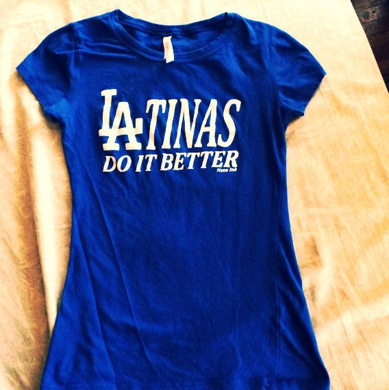 LA Dodger fans!! Check out this Dodger Blue Tee. Girl fitted short sleeve, cinched waist line, longer length. Super cute.