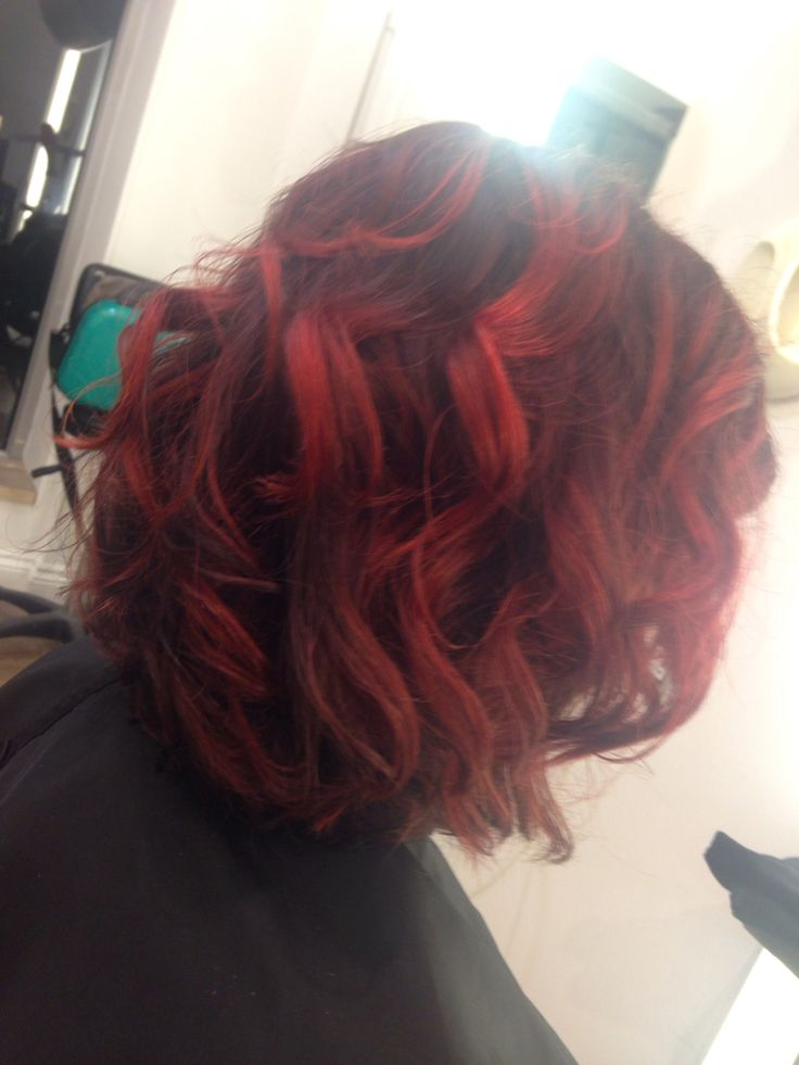 Ballyage red, deep red base with lightened ends. Curls using the Ghd wand.