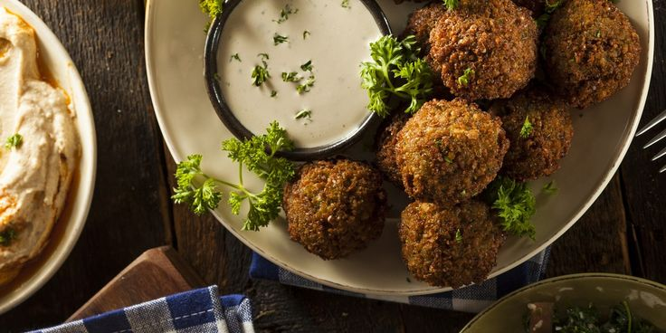 Every Israeli has an opinion about falafel, the ultimate Israeli street food, which is most often served stuffed into pita bread.