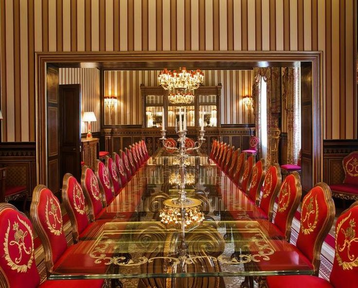 Marvelous This London Mega Mansion Has A Dark Wood Wainscot, Bold Striped Wall Paper,  Long Glass Dining Table With Ornate Legs, Red Velvet Chairs With Gold  Details ... Pictures Gallery