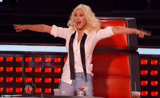 She's so excited: Christina Aguilera jumped out of her chair as she liked what she heard