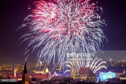 Stock Photo : Firework Exploding Over City Against Sky At Night