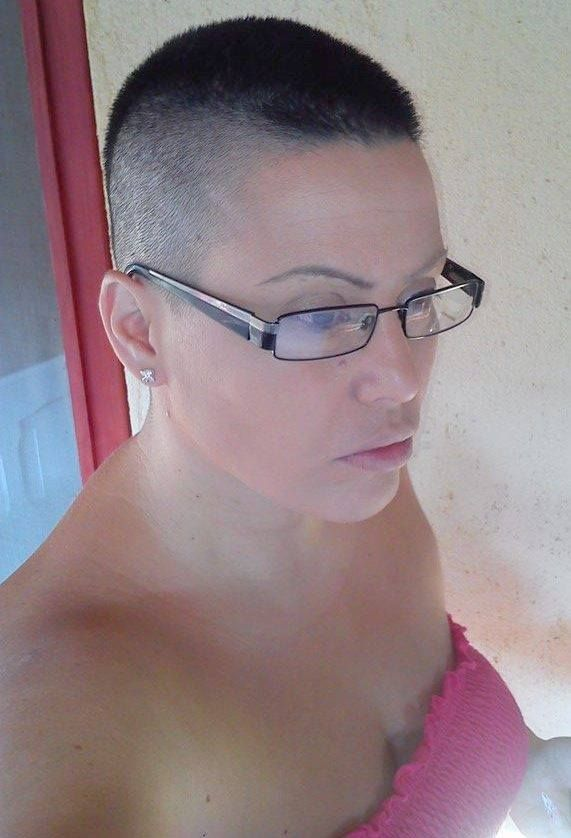 crewed short hair and glasses