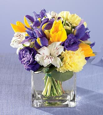 purple iris, white alstromeria with yellow tulips reception wedding flowers,  wedding decor, wedding flower centerpiece, wedding flower arrangement, add pic source on comment and we will update it. www.myfloweraffair.com can create this beautiful wedding flower look.