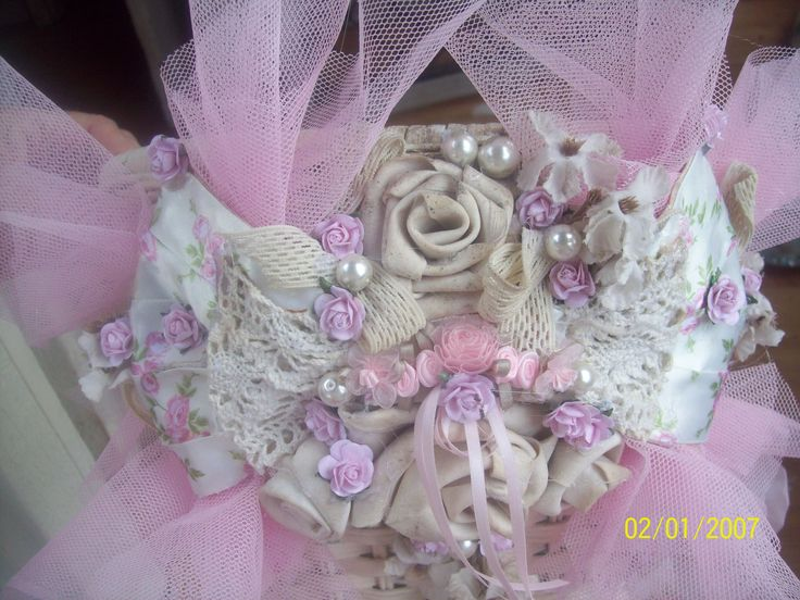 I added a floral embellishment to center of bow with dangling ribbons.