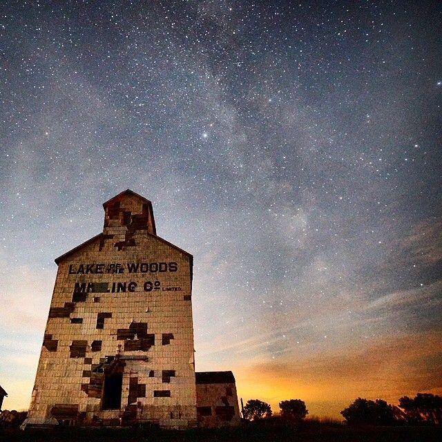 The night sky shines over a prairie sentinel in Manitoba. Stunning #exploremb moment via @winterhawk_ig.